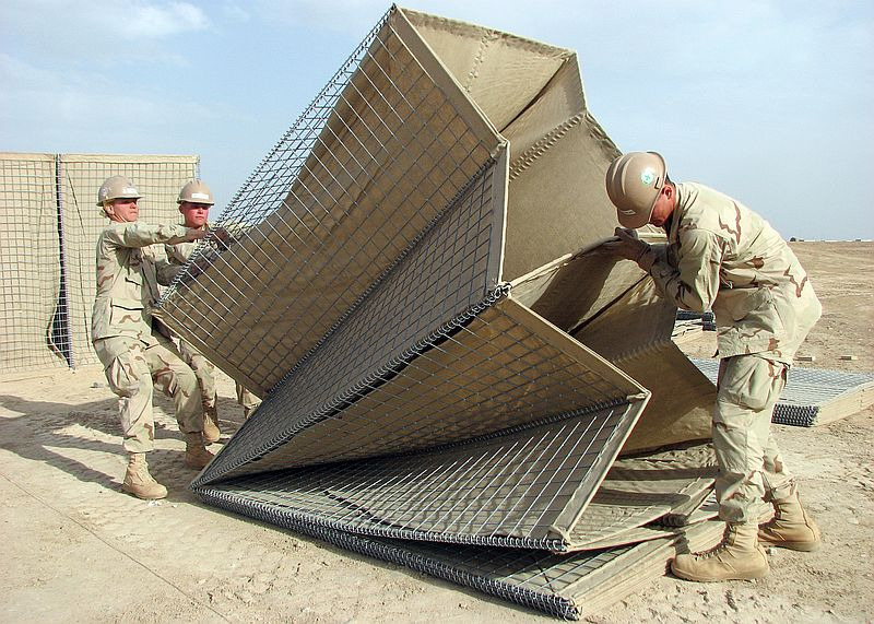 United States Navy sailors assembling HESCO bastions.